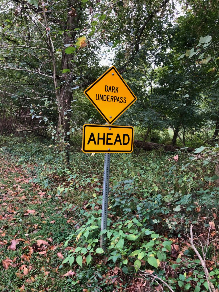 Dark Underpass Sign