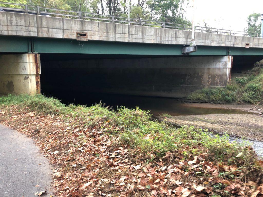 Dark underpass over standing water