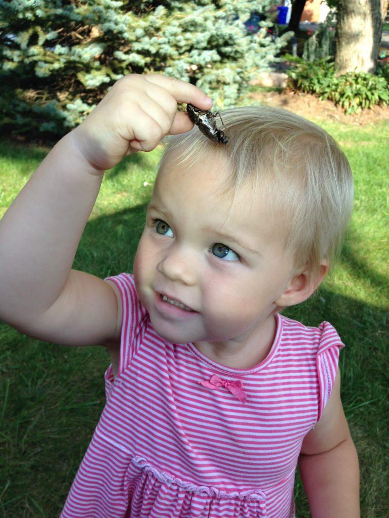 Girl holding bug